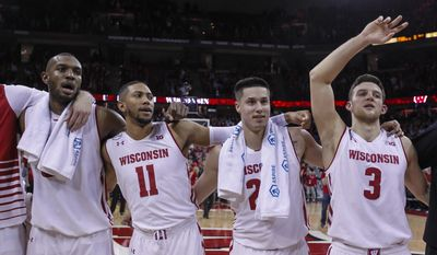 Wisconsin's Vitto Brown, left, Jordan Hill, Bronson Koenig and Zak Showalter (3) sing Varsity after Wisconsin's 66-49 win over Minnesota in an NCAA college basketball game, Sunday, March 5, 2017, in Madison, Wis. (AP Photo/Andy Manis)