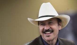 Musician and political novice Rob Quist smiles after wining the Montana Democratic Party's nomination for the May 25 special election, in Helena, Mont., Sunday, March 5, 2017. Quist on Sunday captured the Democratic nomination for the May 25 special election to fill the state's only congressional seat. (Thom Bridge/Independent Record via AP)