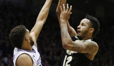 Purdue forward Vincent Edwards, right, shoots over Northwestern guard/forward Sanjay Lumpkin during the first half of an NCAA college basketball game Sunday, March 5, 2017, in Evanston, Ill. (AP Photo/Nam Y. Huh)