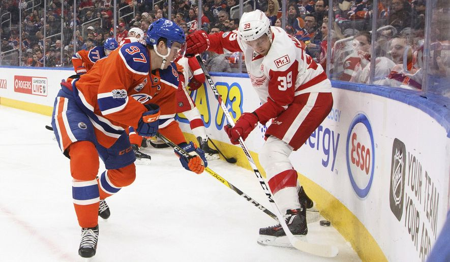 Detroit Red Wings' Anthony Mantha (39) and Edmonton Oilers' Connor McDavid (97) vie for the puck during the second period of an NHL hockey game Saturday, March 4, 2017, in Edmonton, Alberta. (Jason Franson/The Canadian Press via AP)