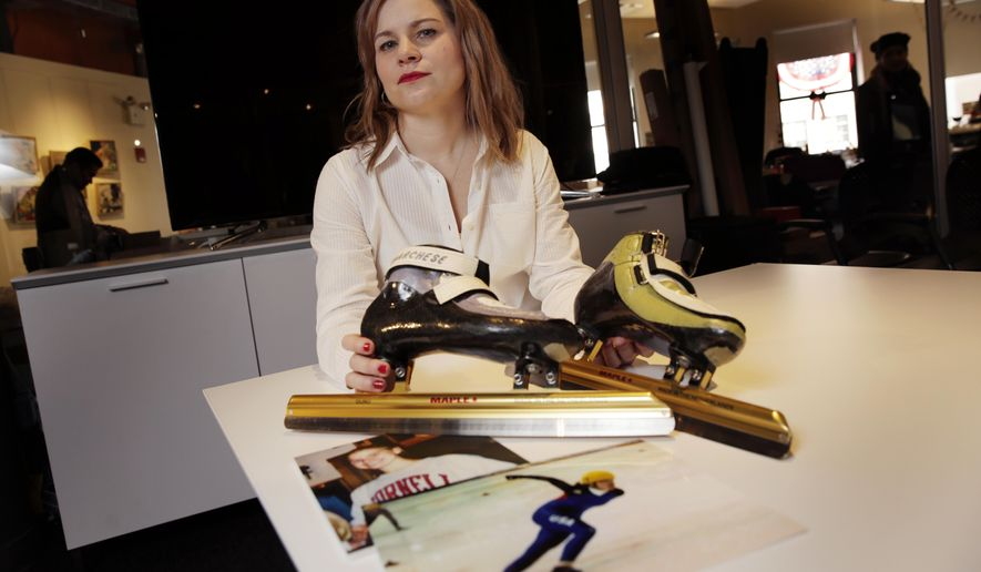 In this March 3, 2017, photo, former competitive speedskater Bridie Farrell poses in New York with a pair of her skates and photos of herself as a young skater. Farrell, who says that as a 15-year-old she was sexually abused repeatedly by a 33-year-old teammate, is hoping, like other survivors of child molestation, that this may be the year New York passes a law lifting one of the nation's tightest statutes of limitations on filing criminal charges and lawsuits against their abusers. (AP Photo/Richard Drew)