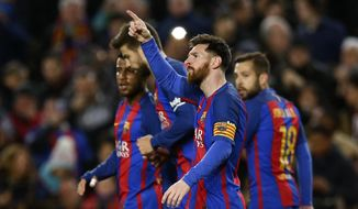 FC Barcelona's Lionel Messi gestures after scoring during the Spanish La Liga soccer match between FC Barcelona and Celta Vigo at the Camp Nou in Barcelona, Spain, Saturday, March 4, 2017. (AP Photo/Manu Fernandez)