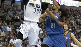 Dallas Mavericks guard Seth Curry (30) drives to the basket against Oklahoma City Thunder forward Andre Roberson (21) during the second half of an NBA basketball game in Dallas, Sunday, March 5, 2017. The Mavericks won 104-89. (AP Photo/LM Otero)