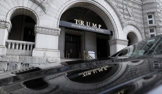 In this photo taken Dec. 21, 2016, the Trump International Hotel in Washington. Trump's $200 million hotel inside the federally owned Old Post Office building has become the place to see, be seen, drink, network, even live, for the still-emerging Trump set. It's a rich environment for lobbyists and anyone hoping to rub elbows with Trump-related politicos, despite the veil of ethics questions that hangs overhead. (AP Photo/Alex Brandon)