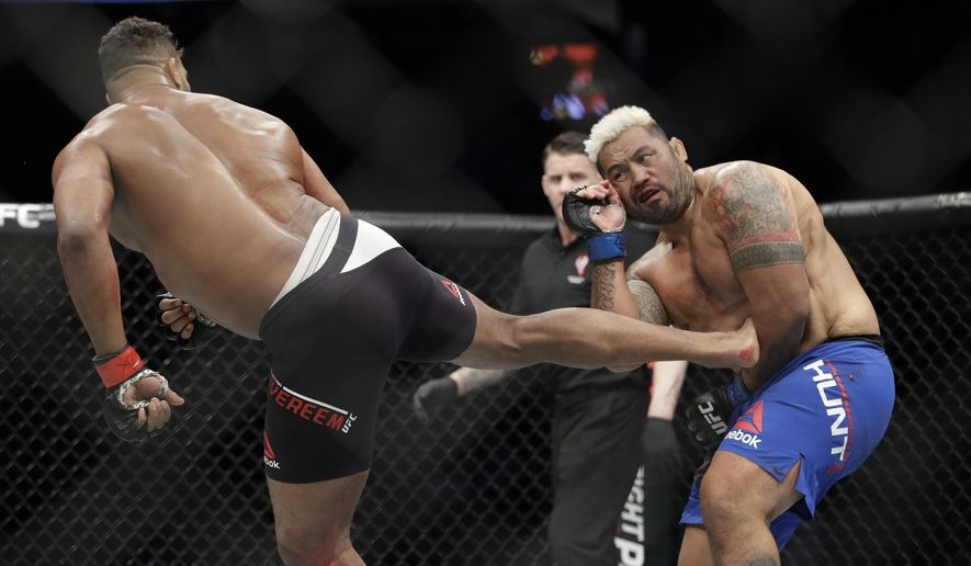 Alistair Overeem kicks Mark Hunt during a heavyweight mixed martial arts bout at UFC 209, Saturday, March 4, 2017, in Las Vegas. (AP Photo/John Locher)