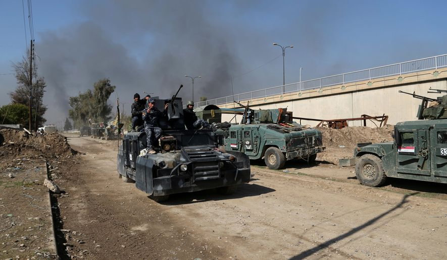 Iraqi security forces advanced during fighting against Islamic State militants in western Mosul on Monday. In a series of fast-paced developments, coalitions suddenly closed in on a key provincial government complex in the city's Dawasa enclave, prompting a wave of optimistic projections from Iraqi commanders. (Associated Press)