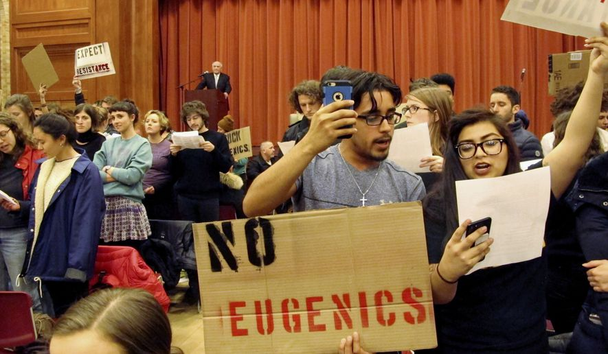 In this Thursday, March 2, 2017, file photo, Middlebury College students turn their backs to author Charles Murray during his lecture in Middlebury, Vt. The college says it has initiated an independent investigation into the protest in which the author of a book discussing racial differences in intelligence was shouted down during the guest lecture and a professor was injured. (AP Photo/Lisa Rathke, File)