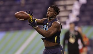 Michigan linebacker Jabrill Peppers runs a drill at the NFL football scouting combine Monday, March 6, 2017, in Indianapolis. (AP Photo/David J. Phillip)