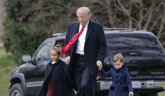 President Donald Trump walks with his grandchildren Arabella Kushner and Joseph Kushner across the South Lawn of the White House in Washington, Friday, March 3, 2017, before boarding Marine One helicopter for the short flight to nearby Andrews Air Force Base, Friday, March 3, 2017. (AP Photo/Pablo Martinez Monsivais)