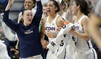 Connecticut's Tierney Lawlor, left, celebrates with Gabby Williams, center, and Kia Nurse, right, during the second half of an NCAA college basketball game against South Florida in the American Athletic Conference tournament finals at Mohegan Sun Arena, Monday, March 6, 2017, in Uncasville, Conn. (AP Photo/Jessica Hill)