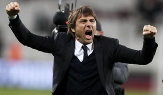 Chelsea manager Antonio Conte celebrates after his team defeated West Ham 2-1 in their English Premier League soccer match at London Stadium, Monday, March 6, 2017. (AP Photo/Kirsty Wigglesworth)