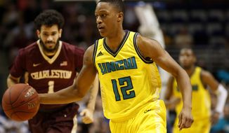 UNC Wilmington's C.J. Bryce, right, dribbles up court against College of Charleston's Grant Riller, left, during the first half of an NCAA college championship basketball game in the Colonial Athletic Association tournament at the North Charleston Coliseum in North Charleston, S.C., Monday, March 6, 2017. (AP Photo/Mic Smith)