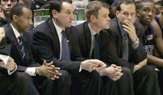 FILE - In this Feb. 6, 2008, file photo, from left, Duke assistant head coach Johnny Dawkins, head coach Mike Krzyzewski, assistant coaches Steve Wojciechowski, and Chris Collins watch during a college basketball game against North Carolina in Chapel Hill, N.C. The Duke coaching tree is blossoming in the Midwest. Marquette coach Steve Wojciechowski and Northwestern counterpart Chris Collins share a bond that dates back to their days at Duke as point guards and assistants under Mike Krzyzewski. Now the close friends are leading programs on the rise, at schools separated by just a 75-mile drive on Interstate 94. (AP Photo/Gerry Broome, File)