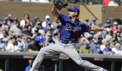 Los Angeles Dodgers' Scott Kazmir throws during the first inning of a spring training baseball game against the Colorado Rockies, Monday, March 6, 2017, in Scottsdale, Ariz. (AP Photo/Darron Cummings)