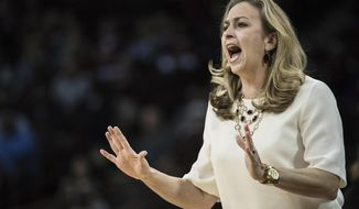 FILE- In this Feb. 11, 2016 file photo, Florida head coach Amanda Butler communicates with her team during the first half of an NCAA college basketball game against South Carolina in Columbia, S.C. Florida fired Butler on Monday, March 6, 2017 parting ways with her after 10 seasons at her alma mater and on her 45th birthday. (AP Photo/Sean Rayford, file)