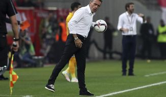 FILE - In this Thursday, Sept. 29, 2016 file photo Olympiakos' coach Paulo Bento holds the ball during the Europa League Group B soccer match between Olympiakos and APOEL at Georgios Karaiskakis stadium in Piraeus port, near Athens. Olympiakos fired the Portuguese coach on Monday, March 6, 2017 after a weekend loss to league contender PAOK. (AP Photo/Petros Giannakouris, File)