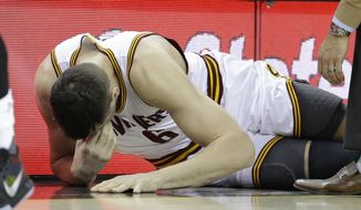 Cleveland Cavaliers' Andrew Bogut (6) grimaces after getting hurt in the first half of an NBA basketball game against the Miami Heat, Monday, March 6, 2017, in Cleveland. (AP Photo/Tony Dejak)