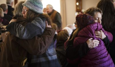 Congregants of the Warwick Trinitarian Congregational Church comfort one another Sunday, March 5, 2017, during a service that remembers a mother and multiple children that were killed in a house fire early Saturday in Warwick, Mass. (Keith Bedford/Globe Staff)/The Boston Globe via AP)