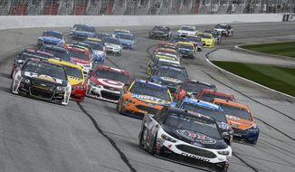 Kevin Harvick leads off the start during a NASCAR Monster Cup series auto race at Atlanta Motor Speedway in Hampton, Ga., Sunday, March 5, 2017. (AP Photo/John Amis)