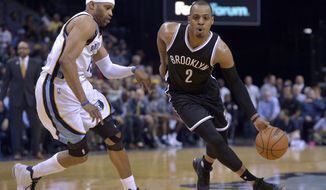 Brooklyn Nets guard Randy Foye (2) drives against Memphis Grizzlies guard Vince Carter in the second half of an NBA basketball game Monday, March 6, 2017, in Memphis, Tenn. (AP Photo/Brandon Dill)