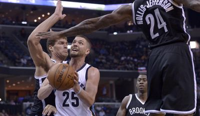 Memphis Grizzlies forward Chandler Parsons (25) drives between Brooklyn Nets center Brook Lopez, left, forward Rondae Hollis-Jefferson (24) and guard Caris LeVert (22) in the first half of an NBA basketball game Monday, March 6, 2017, in Memphis, Tenn. (AP Photo/Brandon Dill)