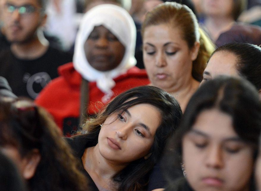 A large crowd listens to speakers during a public dialogue with officials and hundreds of refugees and immigrants at Immaculate Conception Catholic Church, Sunday, March 5, 2017, in Durham, N.C. (Bernard Thomas/The Herald-Sun via AP)