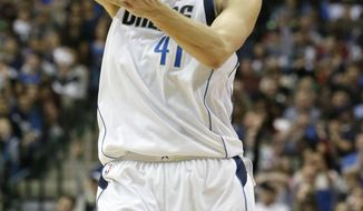 This March 5, 2017 photo shows Dallas Mavericks forward Dirk Nowitzki (41) of Germany reacting to scoring a basket during the second half of an NBA basketball game against the Oklahoma City Thunder in Dallas. Nowitzki sits on the cusp of an exclusive club, needing 20 points Tuesday, March 7, 2017, against the Los Angeles Lakers to join Kobe Bryant and four Hall of Famers as the only NBA players with 30,000 points. (AP Photo/LM Otero)