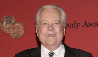In this May 19, 2014, file photo, Robert Osborne attends the 73rd Annual George Foster Peabody Awards in New York. Osborne, the genial face of Turner Classic Movies and a walking encyclopedia of classic Hollywood, has died. He was 84.  A publicist for the network said he passed away Monday, March 6, 2017 in New York. (Photo by Evan Agostini/Invision/AP, File)