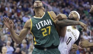 Utah Jazz center Rudy Gobert (27) and New Orleans Pelicans forward DeMarcus Cousins (0) battle for position under the boards during the first half in an NBA basketball game Monday, March 6, 2017, in Salt Lake City. (AP Photo/Rick Bowmer)