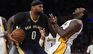 New Orleans Pelicans forward DeMarcus Cousins, left, charges Los Angeles Lakers center Tarik Black during the first half of an NBA basketball game, Sunday, March 5, 2017, in Los Angeles. (AP Photo/Mark J. Terrill)
