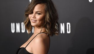 "FILE - In this Feb. 28, 2017, file photo, model Chrissy Teigen poses at the season two premiere of the television series ""Underground"" in Los Angeles. Teigen revealed in an essay for Glamour magazine published online on March 6, 2017, that she has battled postpartum depression since the birth of her daughter last year. (Photo by Chris Pizzello/Invision/AP, File)"