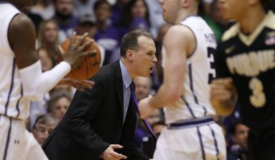 Northwestern head coach Chris Collins reacts as he watches his team during the second half of an NCAA college basketball game against Purdue Sunday, March 5, 2017, in Evanston, Ill. (AP Photo/Nam Y. Huh)