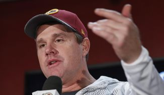 In this photo taken Jan. 1, 2017, Washington Redskins head coach Jay Gruden speaks during a news conference in Landover, Md. The Washington Redskins have signed Gruden to a multi-year contract extension. (AP Photo/Alex Brandon) **FILE**