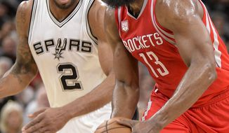 Houston Rockets guard James Harden (13) drives past San Antonio Spurs forward Kawhi Leonard during the first half of an NBA basketball game, Monday, March 6, 2017, in San Antonio. (AP Photo/Darren Abate)