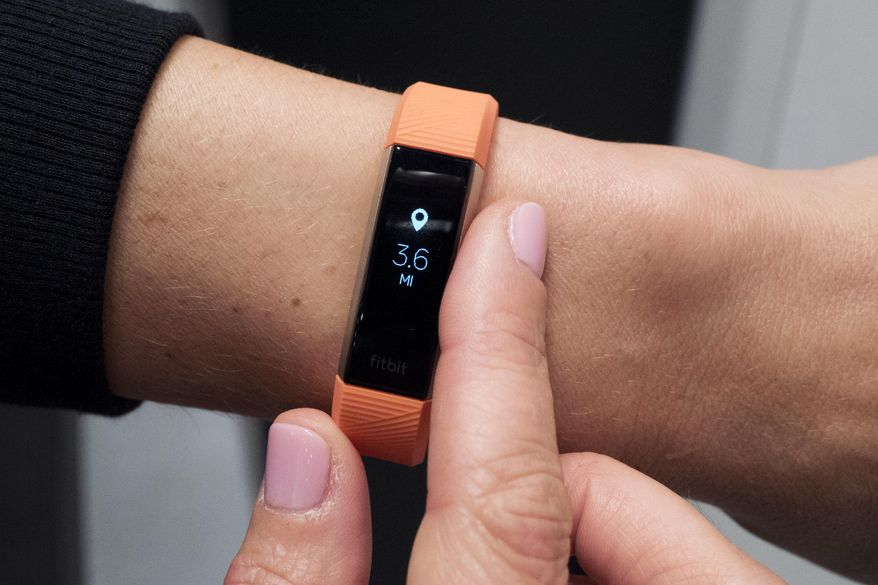 In this March 1, 2017 photo, Fitbit's new Alta HR device is displayed in New York. The company known for encouraging people to walk 10,000 steps each day, now wants to put them to sleep as well. (AP Photo/Mark Lennihan) ** FILE **