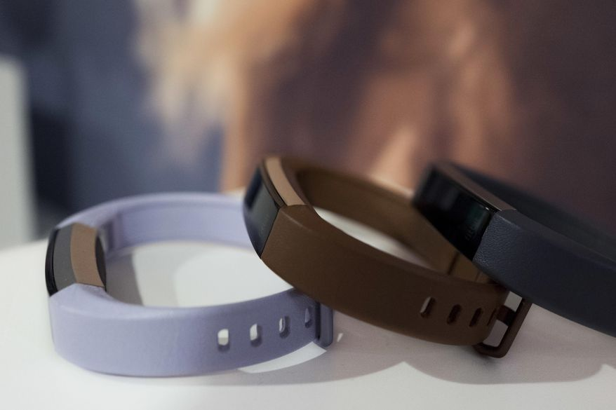 In this March 1, 2017 photo in New York, Fitbit's new Alta HR is shown in several colors. The new sleep tools come as Fitbit announces an updated version of its Alta tracker. The new version has heart rate monitoring and seven days of battery life. It goes on sale in April for about $150. (AP Photo/Mark Lennihan)