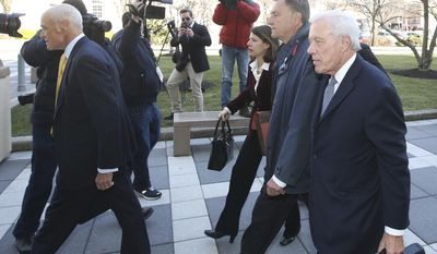 David Samson, second right, the former chairman of the Port Authority follows attorney Michael Chertoff, left, as they arrive at Federal Court for Samson's sentencing, Monday, March 6, 2017, in Newark, NJ. Samson pleaded guilty last year for pressuring the airline to revive a money-losing flight from Newark Liberty International Airport to an airport near his weekend home in South Carolina in 2012.  (Ed Murray/NJ Advance Media via AP)