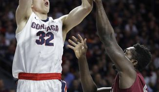 Gonzaga's Zach Collins shoots over Santa Clara's Emmanuel Ndumanya during the first half of a West Coast Conference tournament NCAA college basketball game Monday, March 6, 2017, in Las Vegas. (AP Photo/John Locher)