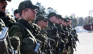 Swedish military recruits are shown standing at attention in this file photo from March 2017. (Associated Press)  **FILE**
