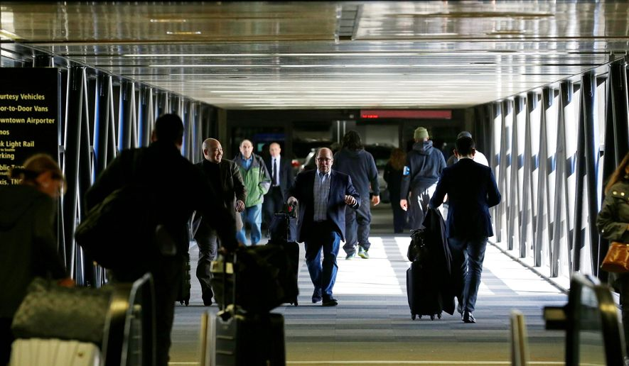 Airport officials and civil rights lawyers across the U.S. are getting ready to face President Trump's latest travel ban, which no longer affects Iraqi visitors. (Associated Press)