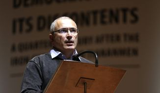 Mikhail Khodorkovsky says President Trump may convince Russian President Vladimir Putin that it is in his best interest to step down. (AP Photo/Petr David Josek)