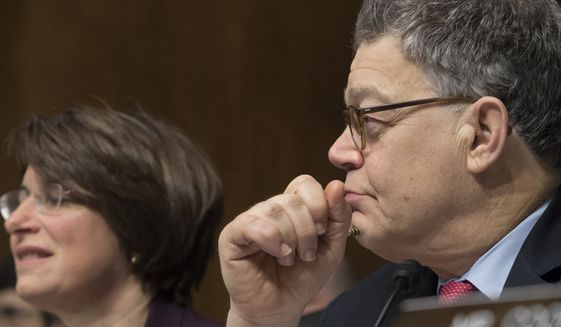 Senate Judiciary Committee members, Sen. Al Franken, D-Minn., right, with Sen. Amy Klobuchar, D-Minn., listen as Committee Chairman Sen. Chuck Grassley, R-Iowa, comments on updated clarification by Attorney General Jeff Sessions about his confirmation hearing testimony and his acknowledgment of having spoken with the Russian ambassador, Tuesday, March 7, 2017, on Capitol Hill in Washington. (AP Photo/J. Scott Applewhite)