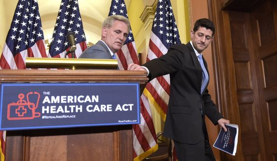 House Speaker Paul Ryan of Wis., right, takes his notes as he and House Majority Whip Kevin McCarthy, R-Calif., walk away following a news conference on the American Health Care Act on Capitol Hill in Washington, Tuesday, March 7, 2017. (AP Photo/Susan Walsh)