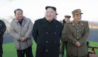 In this image made from video released by KRT on Tuesday, March 7, 2017, North Korean leader Kim Jong Un, center, reacts during the launch of four missiles in an undisclosed location North Korea. On Monday, North Korea fired four ballistic missiles in an apparent protest against ongoing U.S.-South Korean military drills that it views as an invasion rehearsal. (KRT via AP Video)