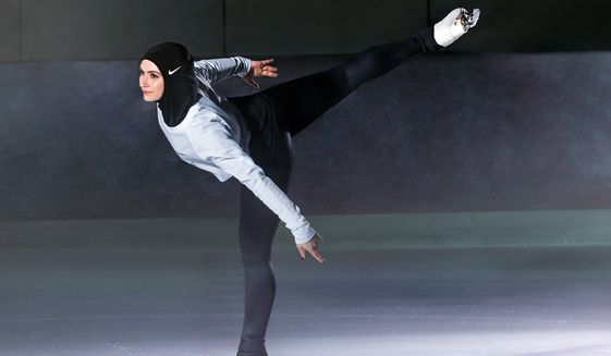 In this undated image provided by Nike, figure skater Zahra Lari model wears Nike's new hijab for Muslim female athletes. The pull-on hijab is made of light, stretchy fabric that includes tiny holes for breathability and an elongated back so it will not come untucked. It will come in three colors: black, vast grey and obsidian. Beaverton-based Nike says the hijab will be available for sale next year.  (Nike via AP)