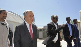 UN Secretary-General Antonio Guterres, centre, walks inside the U.N. compound during his visit to Mogadishu, Somalia, Tuesday , March 7, 2017.  Guterres is conducting high level talks including with Somalia's new President Mohamed Abdullahi Mohamed, to start of what he calls an emergency visit to highlight the country's famine crisis. (AP Photo/Farah Abdi Warsameh)