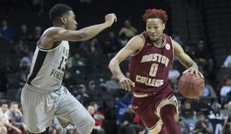 Boston College guard Ky Bowman (0) drives to the basket against Wake Forest guard Bryant Crawford (13) during the first half of an NCAA college basketball game in the Atlantic Coast Conference tournament, Tuesday, March 7, 2017, in New York. (AP Photo/Mary Altaffer)