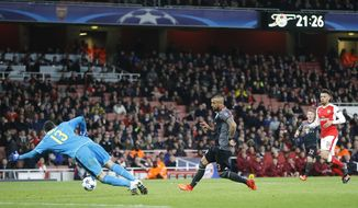 Bayern's Arturo Vidal scores his side's fifth goal past Arsenal goalkeeper David Ospina during the Champions League round of 16 second leg soccer match between Arsenal and Bayern Munich at the Emirates Stadium in London, Tuesday, March 7, 2017. (AP Photo/Frank Augstein)