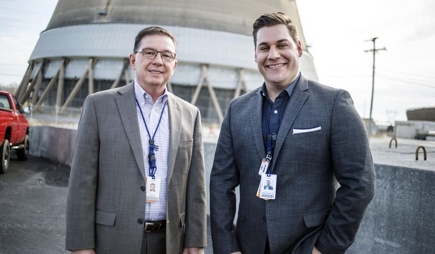 FOR RELEASE SATURDAY, MARCH 11, 2017, AT 3:01 A.M. EST.- This photo taken Feb. 28, 2017, shows Exelon Corporation Three Mile Island nuclear generating station spokesman Ralph DeSantis, left,who is retiring after 38 years on the job. With him is new TMI spokesman Dave Marcheskie. DeSantis has been with TMI since the 1979 partial meltdown of the Unit 2 reactor.  It's been 38 years now, but the long legacy of the March 1979 partial meltdown at the Three Mile Island nuclear power plant lingers to this day. (Dan Gleiter /PennLive.com via AP)