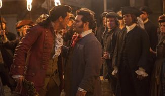 """This image released by Disney shows Luke Evans as Gaston, left, with Josh Gad as LeFou, in """"Beauty and the Beast."""" (Laurie Sparham/Disney via AP)"""